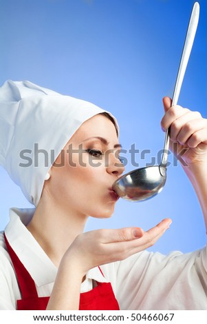 Chef tasting tasteful soup from ladle on blue background