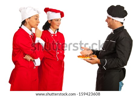 Chef teacher man talking with students women and showing pizza isolated on white background - stock photo