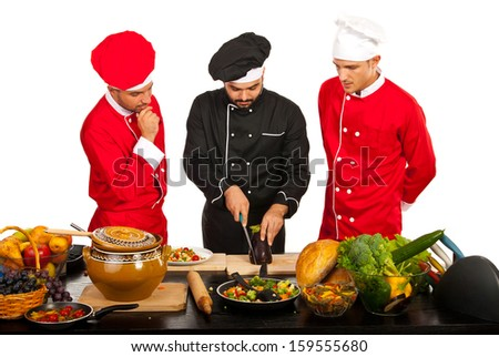 Chef  teacher with students teaching in kitchen - stock photo