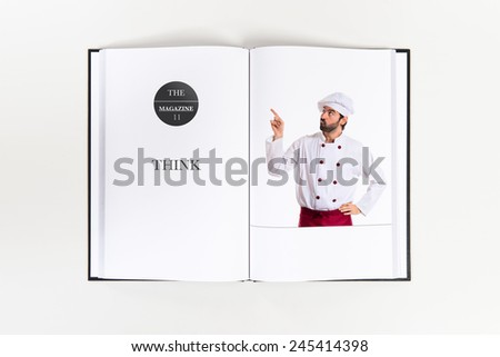 Chef thinking printed on book - stock photo