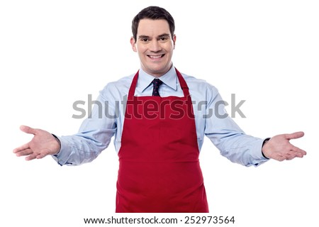 Chef welcoming his guests with wide open arms - stock photo