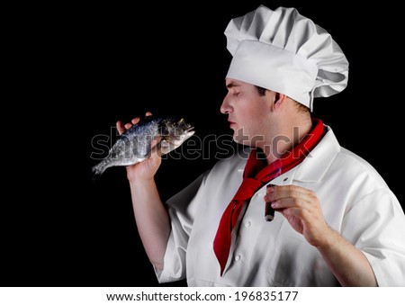 Chef with a  cigar holding raw fish