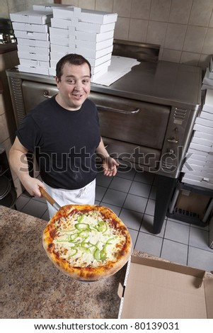 Chef with fresh take out pizza - stock photo