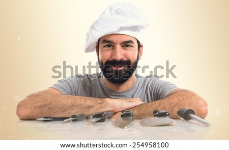 Chef with his knives - stock photo