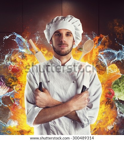 Chef with knives between water and fire - stock photo