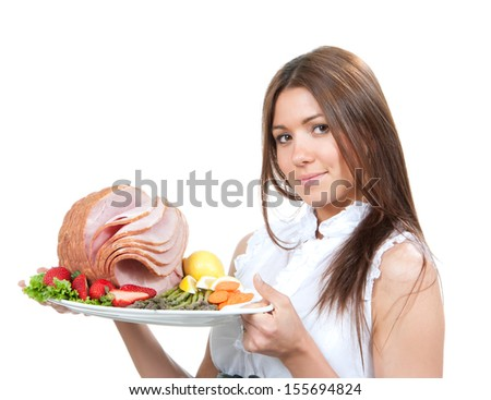 Chef woman holding plate in hands with turkey meat ham decorated lettuce, asparagus, carrot, strawberry and lemon isolated on a white background