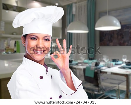 Chef woman in the modern kitchen