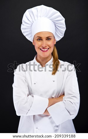 chef woman over dark background standing - stock photo