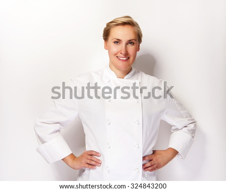 Chef woman over white background with  arms on hips smiling with chef outfit. - stock photo