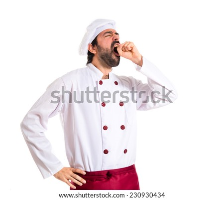 Chef yawning over white background - stock photo