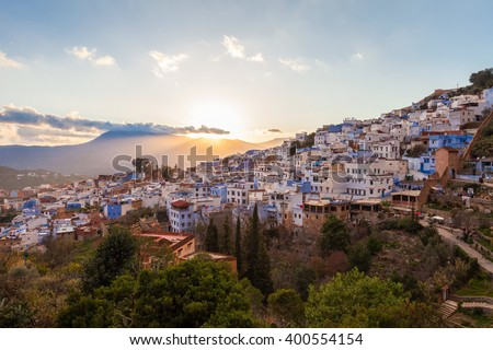 Chefchaouen aerial panoramic view at sunset Chefchaouen is a city in northwest Morocco. Chefchaouen is noted for its buildings in shades of blue. - stock photo