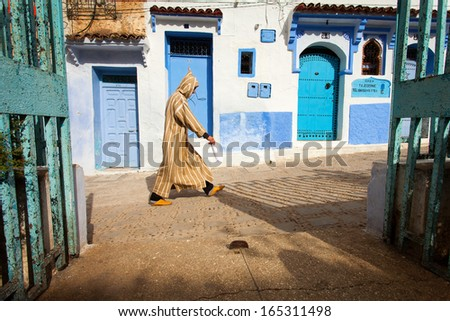 CHEFCHAOUEN, MOROCCO, NOVEMBER 20: person walking on street of the Blue city of Chefchaouen, City is situated in the Rif Mountains in the North of Morocco, 2013