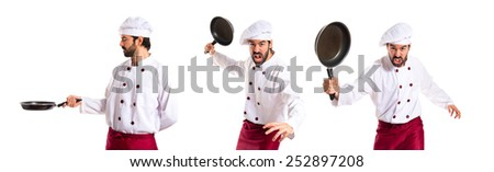 Chefs holding frying pans - stock photo