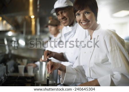 Chefs in a Kitchen - stock photo