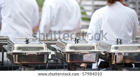 chefs standing in front of their prepared dishes - stock photo