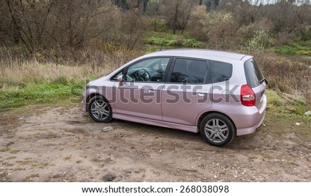 Chekhov, Moscow region, Russia - October 26, 2008: New car photos. Pink Honda Jazz Fit Sport 2008. One of the last made in Japan for Russian market. It has 1.339 liter engine with 83 hp. The - stock photo