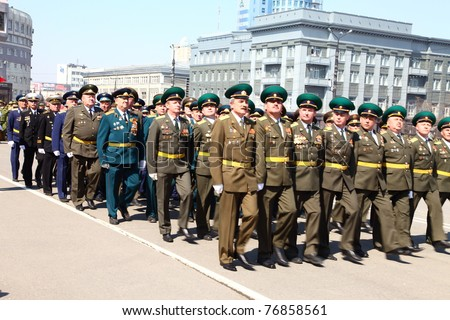 CHELABINSK, RUSSIA - MAY 9: Military parade in honor of 66 anniversary of Victory in Great Patriotic War, 9 May 2011 on Lenin Square in Chelyabinsk, Russia. - stock photo