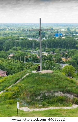 Chelm, Poland - June 12, 2016: The cross on the way of the cross in a park next to the shrine of the Virgin Mary in Chelm in eastern Poland - stock photo