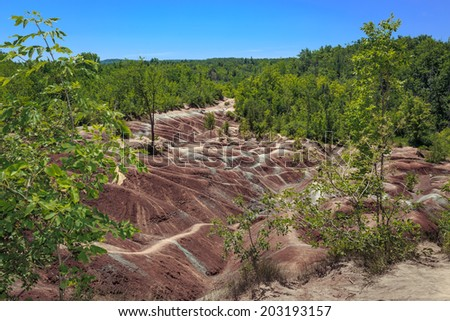 Cheltenham Badlands  background is a small example of badlands formation in Caledon, Ontario.