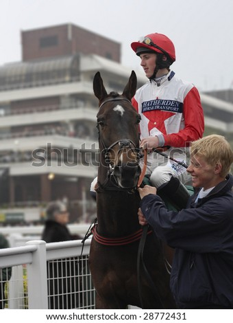 CHELTENHAM, GLOUCS, APRIL 17 2009: Jockey, Jack Doyle rides Kings Forest to the start of the second race at the April National Hunt meeting at Cheltenham Racecourse, UK - stock photo