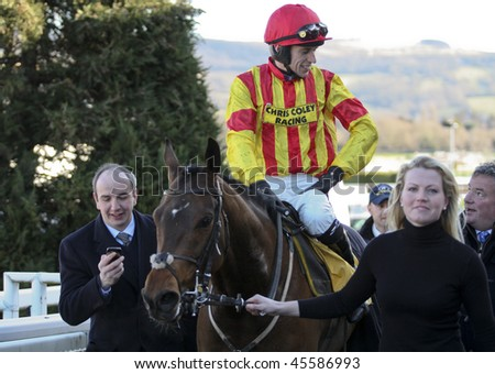 CHELTENHAM, GLOUCS; JAN 30:  Jockey Paddy Brennan returns victorius on Baccalaureate in the first race at Cheltenham Racecourse, UK, January 30, 2010 in Cheltenham, Gloucestershire - stock photo