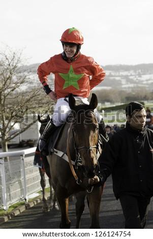CHELTENHAM, GLOUCS-JANUARY 26: Jockey Nick Schofield returns with Sew Me Something in the second race at Festival Trials Day, Cheltenham Racecourse, Cheltenham UK on Jan 26, 2013. - stock photo
