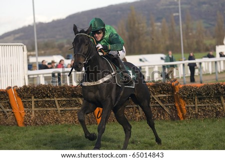CHELTENHAM, GLOUCS; NOV 13: Jockeys battle over hurdles in the first race at Cheltenham Racecourse, UK, November 13, 2010 in Cheltenham, Gloucestershire