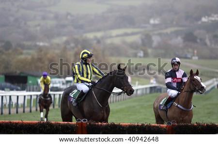 CHELTENHAM, GLOUCS; NOV 14: jockeys jimmy mccarthy and tom molloy inspect the hurdle before the fifth race at Cheltenham Racecourse, UK, November 14, 2009 in Cheltenham, Gloucs - stock photo