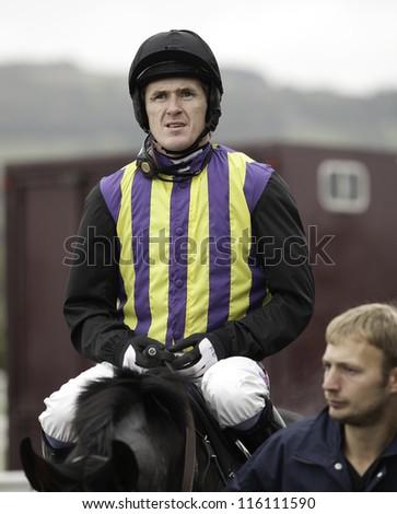 CHELTENHAM, GLOUCS, OCT 19 2012, Jockey A P Mccoy returns from the first race at Cheltenham Racecourse, Cheltenham UK Oct 19 2012 - stock photo