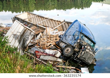 CHELYABINSK REGION, RUSSIA - AUGUST 14, 2009: Semi-trailer truck Freightliner Century Class crashed in the lake from the interurban freeway. - stock photo