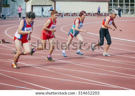 Chelyabinsk, Russia - August 28, 2015:  old women run 100 meters during championship of Russia on track and field athletics among the elderly, Chelyabinsk, Russia - August 28, 2015
