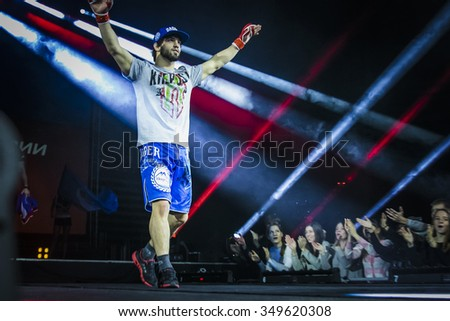 Chelyabinsk, Russia - December 5, 2015: athlete mixed martial arts fighter during presentation before fight welcomes their fans during Cup of Russia MMA - stock photo