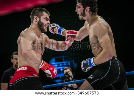 Chelyabinsk, Russia - December 5, 2015: athlete mixed martial arts fighter gets cross hand to his opponent during Cup of Russia MMA