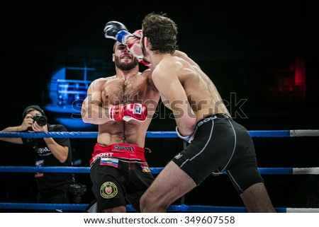 Chelyabinsk, Russia - December 5, 2015: athlete mixed martial arts gets strong jab hand to his opponent during Cup of Russia MMA