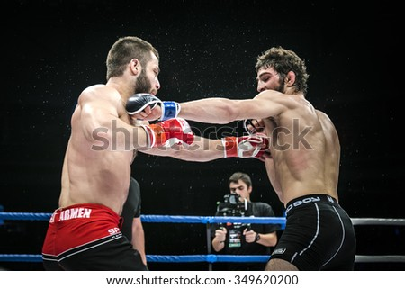 Chelyabinsk, Russia - December 5, 2015: final battle MMA fighters kick hand during Cup of Russia MMA - stock photo
