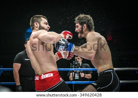 Chelyabinsk, Russia - December 5, 2015: final fight of MMA fighters. splashing water and sweat during Cup of Russia MMA - stock photo