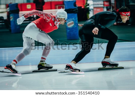 Chelyabinsk; Russia - December 3; 2015: two young men speedskaters warmup before race during Cup of Russia on speed skating