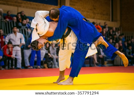 Chelyabinsk, Russia -  December 20, 2015: wrestling match between young male judokas on tatami during All-Russian competition on judo of memory Grigory Verichev - stock photo