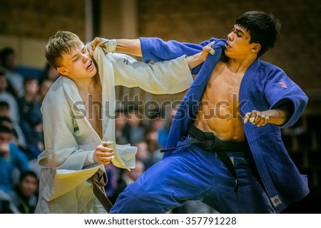Chelyabinsk, Russia -  December 20, 2015: young judoists during fight hold each other for kimono during All-Russian competition on judo of memory Grigory Verichev - stock photo