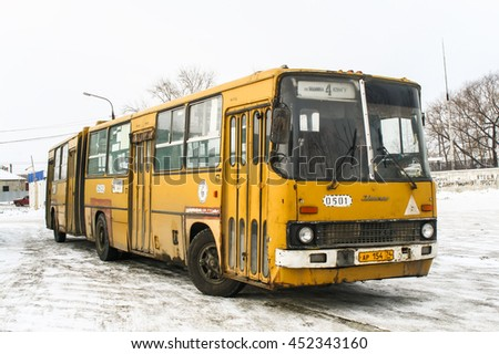 CHELYABINSK, RUSSIA - JANUARY 30, 2011: Articulated city bus Ikarus 280 in the city street. - stock photo