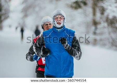 Chelyabinsk, Russia -  January 5, 2016: closeup face in frost of young athlete runner during Chelyabinsk winter marathon