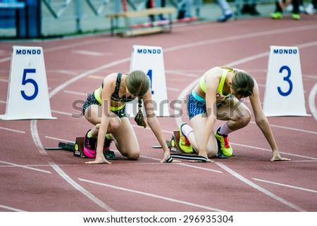 Chelyabinsk, Russia - July 05, 2015:  blind girls athlete in starting position during Championship of Russia on track and field athletics among the blind, Chelyabinsk, Russia - July 05, 2015 - stock photo