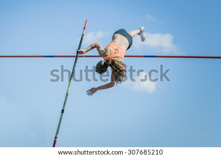 Chelyabinsk, Russia - July 24, 2015: Girl athletes pole vault during National competitions in memory of G. I. Nicewhen athletics - stock photo