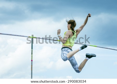 Chelyabinsk, Russia - June 10, 2015: young girl athlete performs successful attempt pole vault during universities championship of Chelyabinsk region in athletics - stock photo
