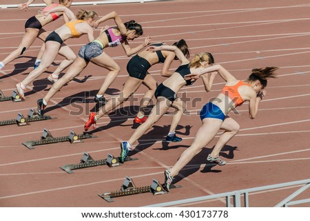 Chelyabinsk, Russia - May 24, 2016: group of girls athletes start to sprint 100 meters during UrFO Championship in athletics - stock photo