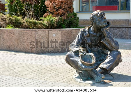 CHELYABINSK,RUSSIA - MAY 3,2016:Metal statue of a man asking for money on the Central street of the city.