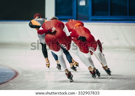 Chelyabinsk, Russia - October 15, 2015: girl speed skaters in warm-up before start of competition during Cup of Russia on speed skating