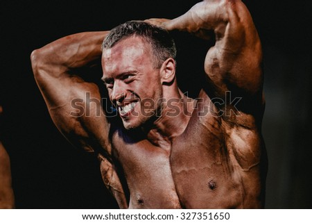 Chelyabinsk, Russia - October 3, 2015: white-toothed smile men bodybuilder during Championship of Chelyabinsk region on bodybuilding, bodyfitness and fitness