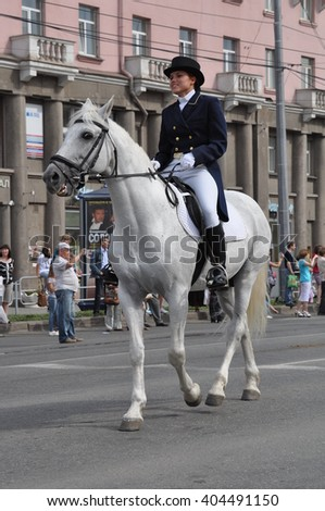 CHELYABINSK,RUSSIA - SEPTEMBER 3,2011: White horse with rider