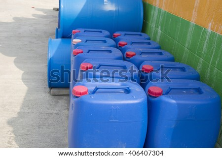 chemical drums on pallets in a warehouse Abstract background - stock photo
